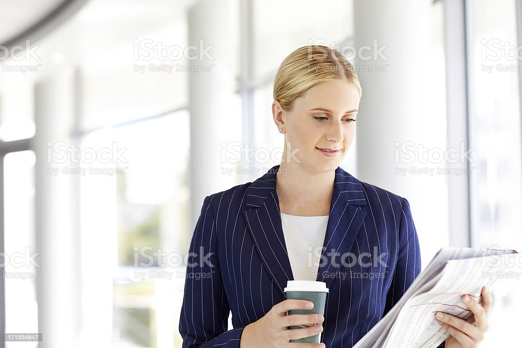 Female Professional Reading Newspaper royalty-free stock photo