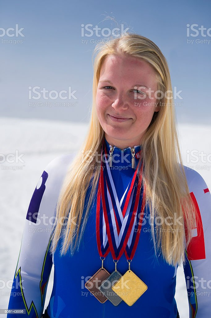 Female professional skier  posing with her medals stock photo
