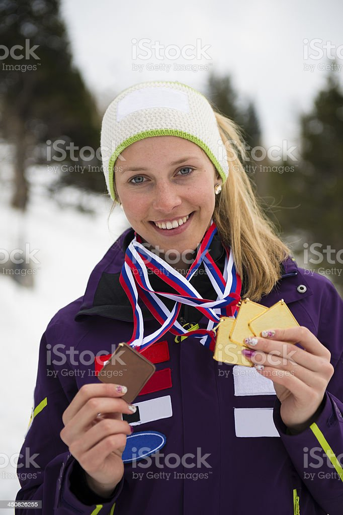 Female professional skier  showing her medals stock photo
