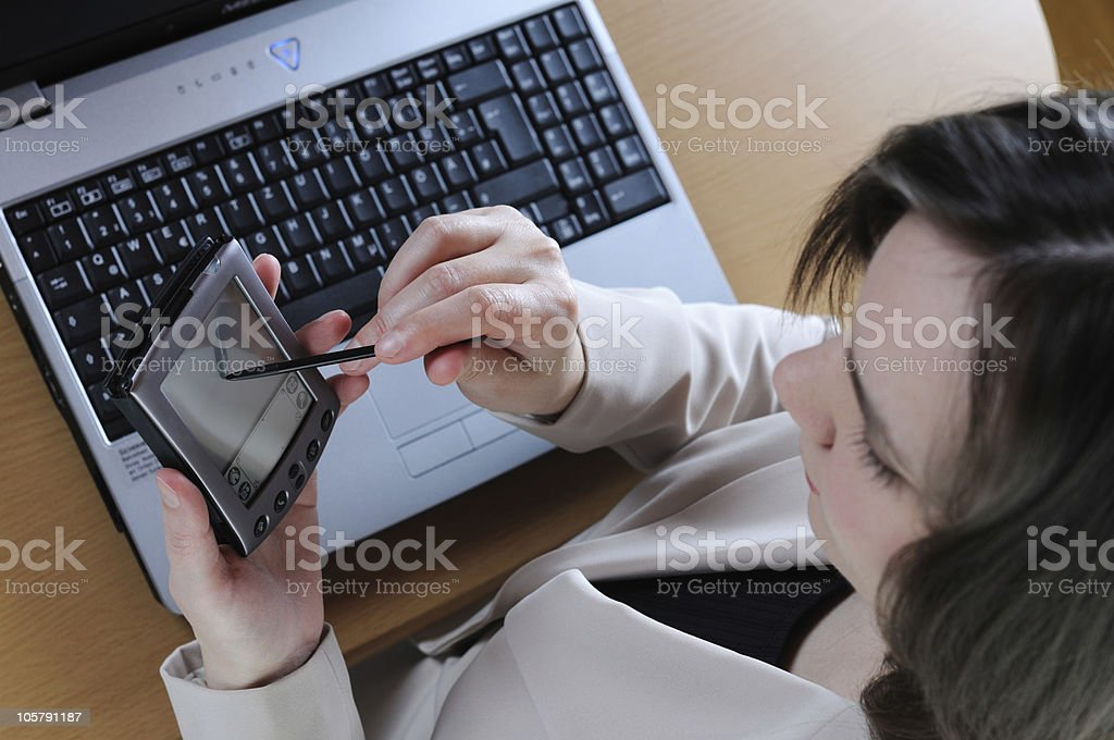 Female Professional working with PDA and  Notebook royalty-free stock photo