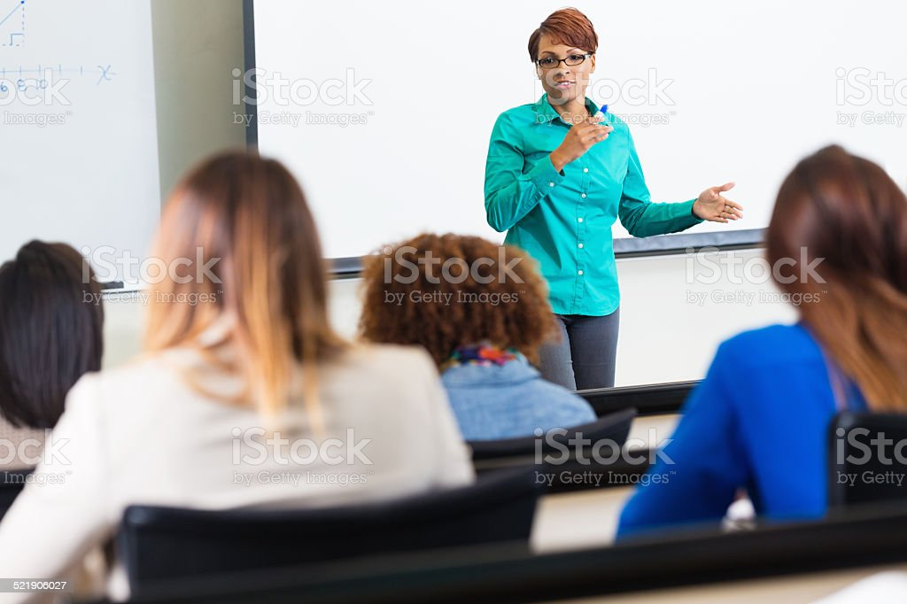 Female professor teaching college class stock photo