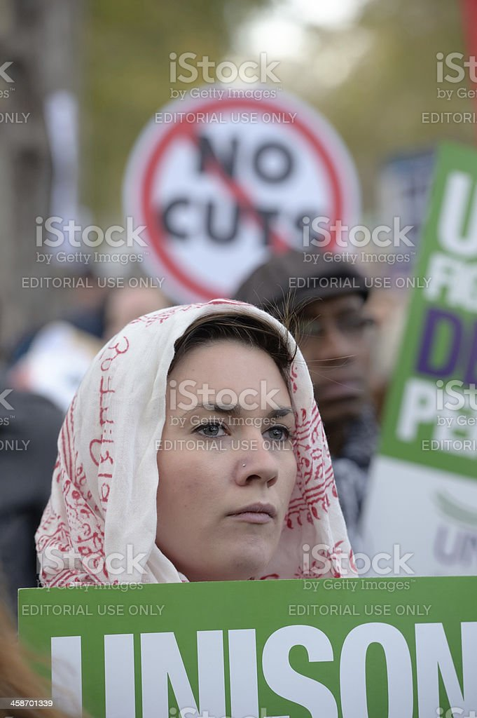 Female protester, striking over public sector pensions, at N30 march, royalty-free stock photo