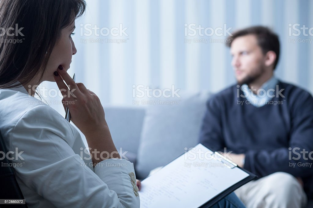 Female psychiatrist talking with patient stock photo