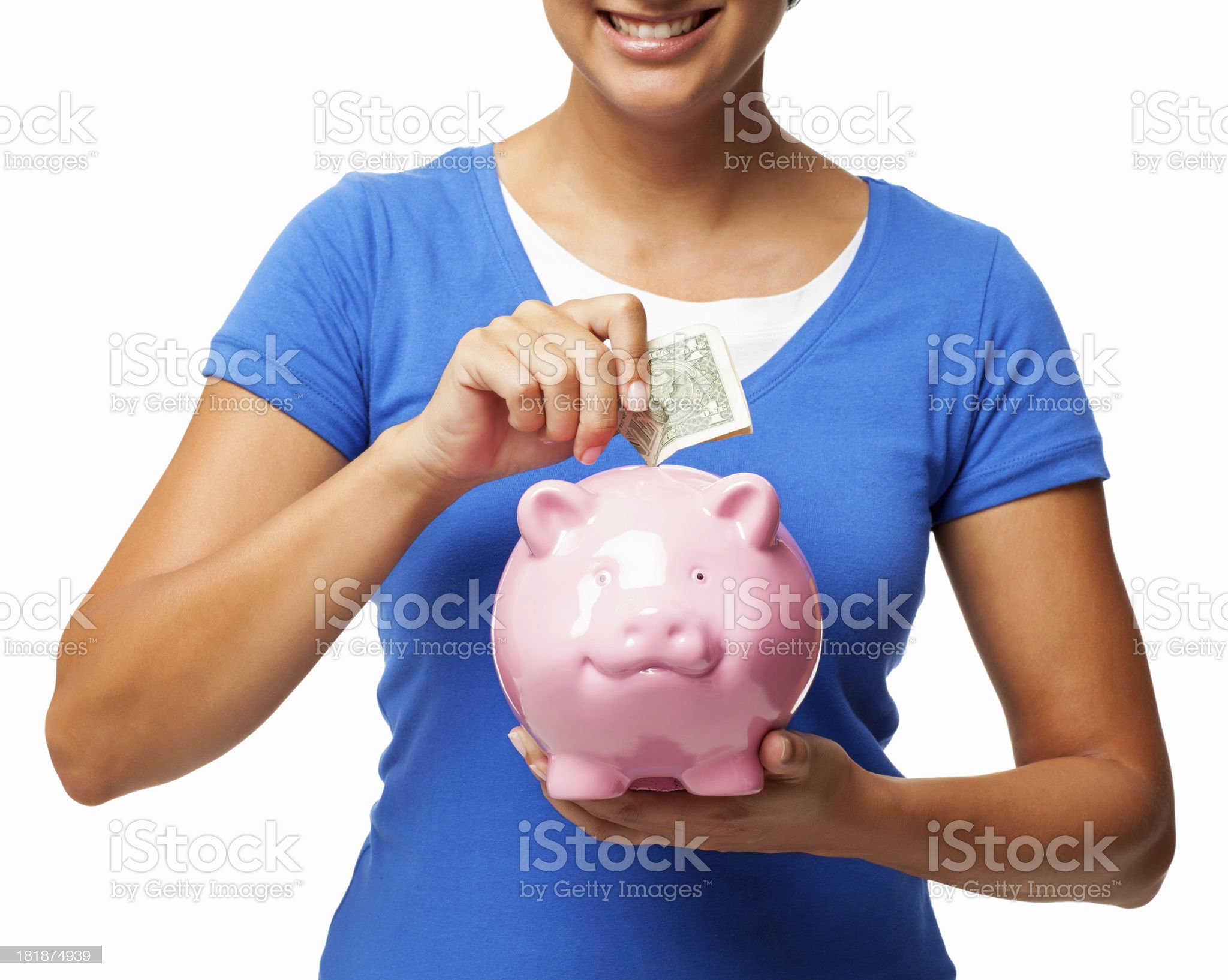 Female Putting Banknote Into Piggy Bank - Isolated royalty-free stock photo