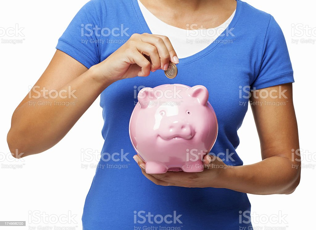 Female Putting Coin Into Piggy Bank - Isolated royalty-free stock photo
