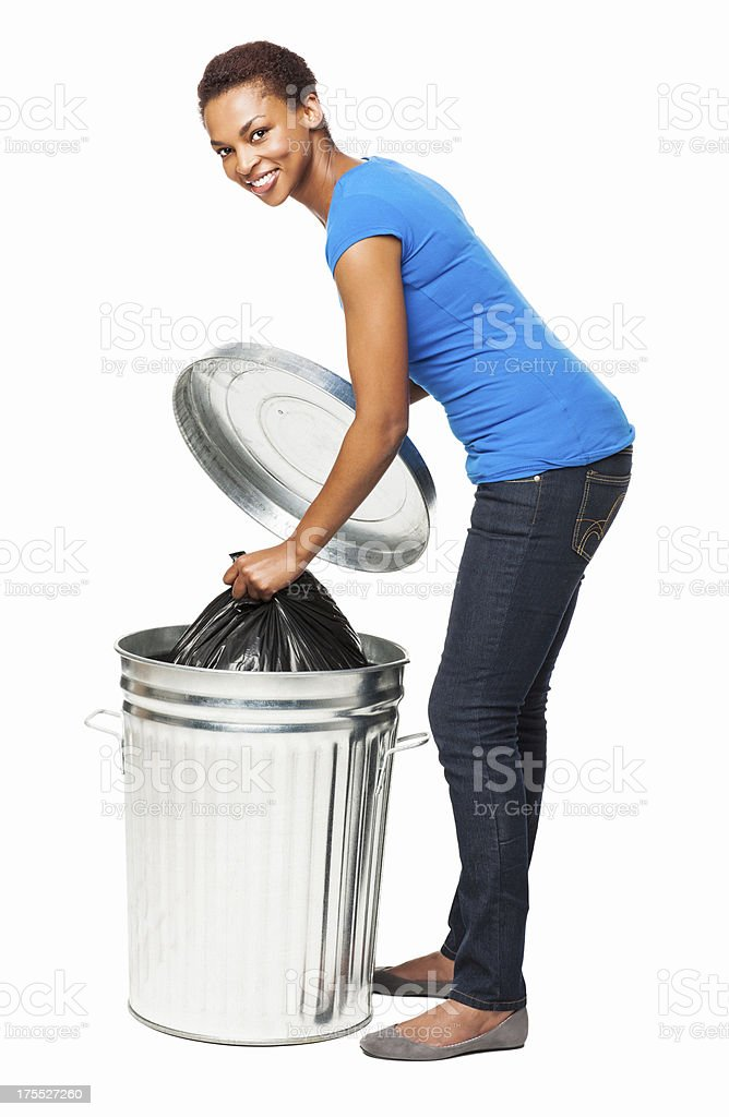 Female Putting Trash Bag In the Garbage Can - Isolated stock photo