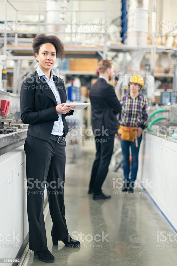 Female quality control inspector at the factory stock photo