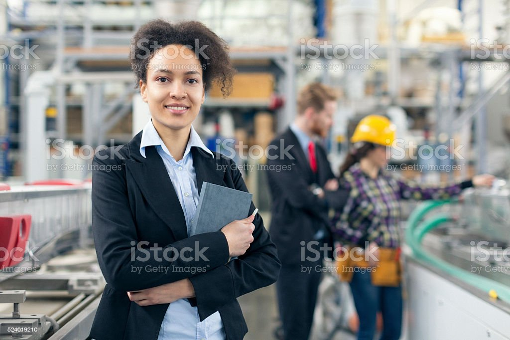Female quality inspector posing for the camera stock photo