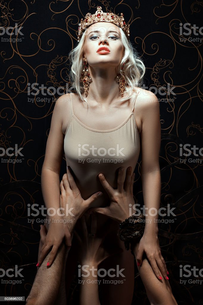 Female queen holding a lot of men's hands. stock photo
