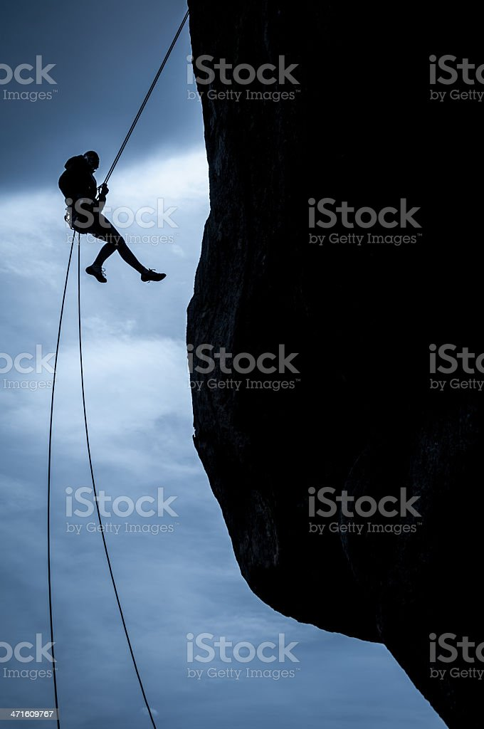Female rappelling royalty-free stock photo