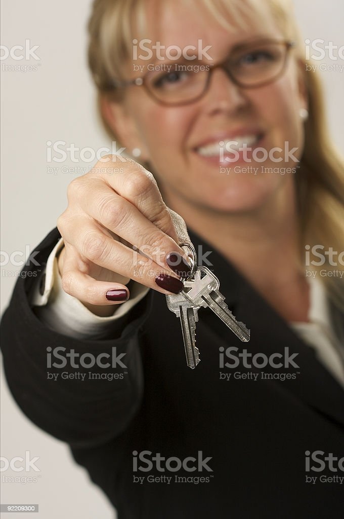 Female Real Estate Agent Handing Over Keys royalty-free stock photo