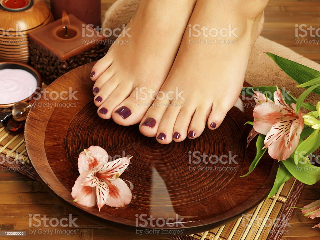 Female receiving pedicure at spa royalty-free stock photo