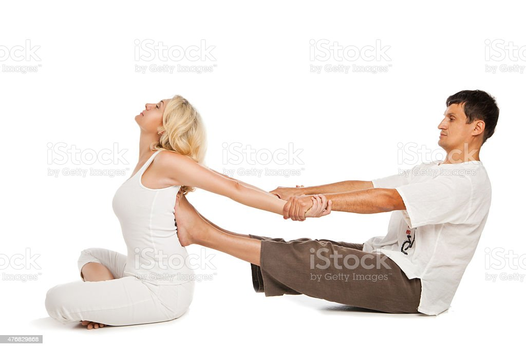 Female receiving traditional thai massage stock photo