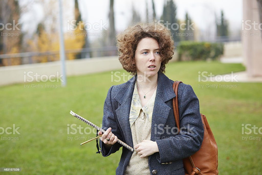 Female redhead student carrying notebook stock photo