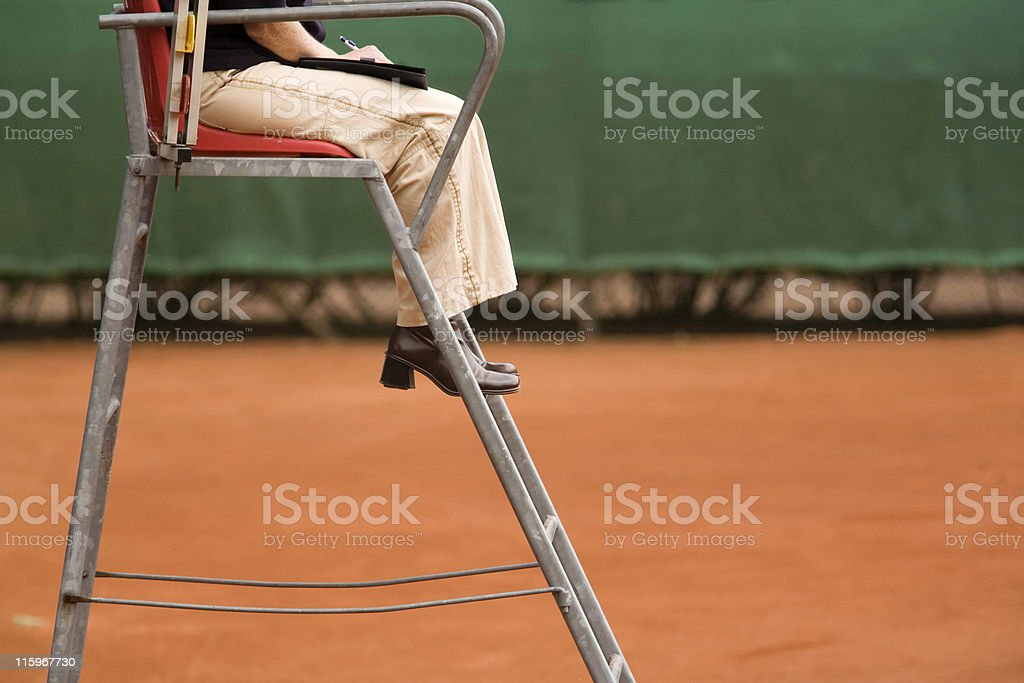female referee on a clay tennis court royalty-free stock photo
