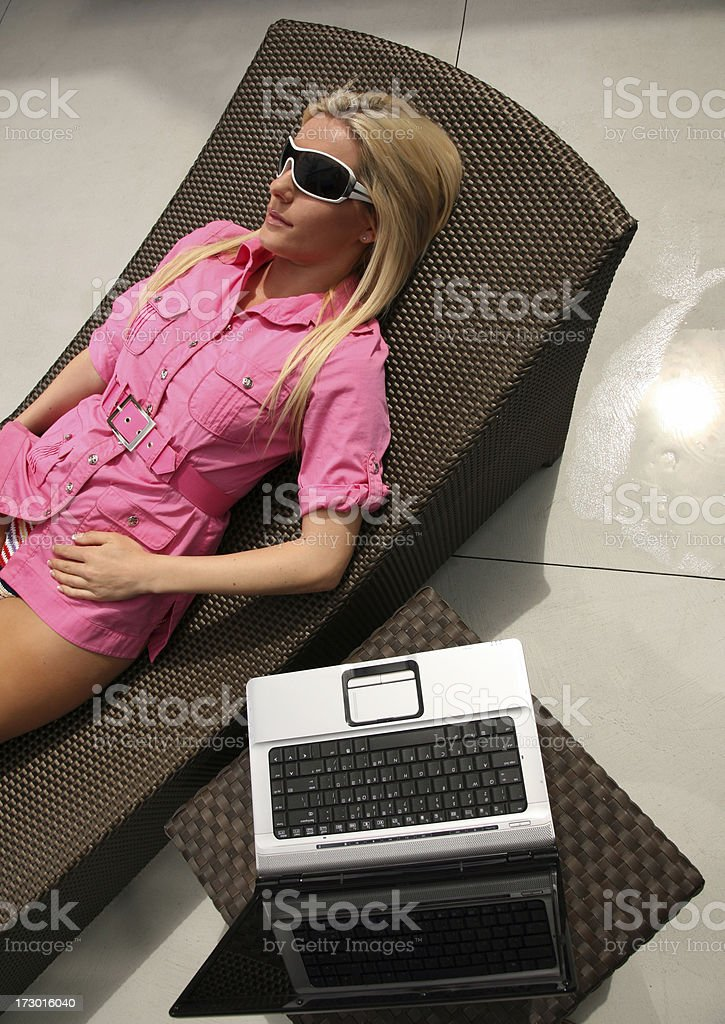 Female relaxing outside with Laptop Computer royalty-free stock photo