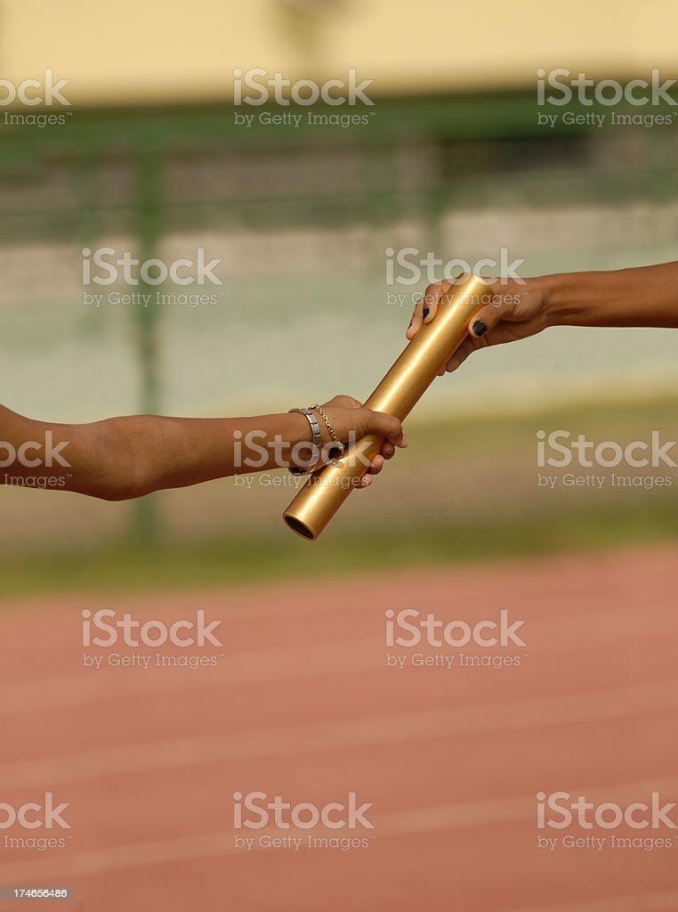 female relay pass stock photo