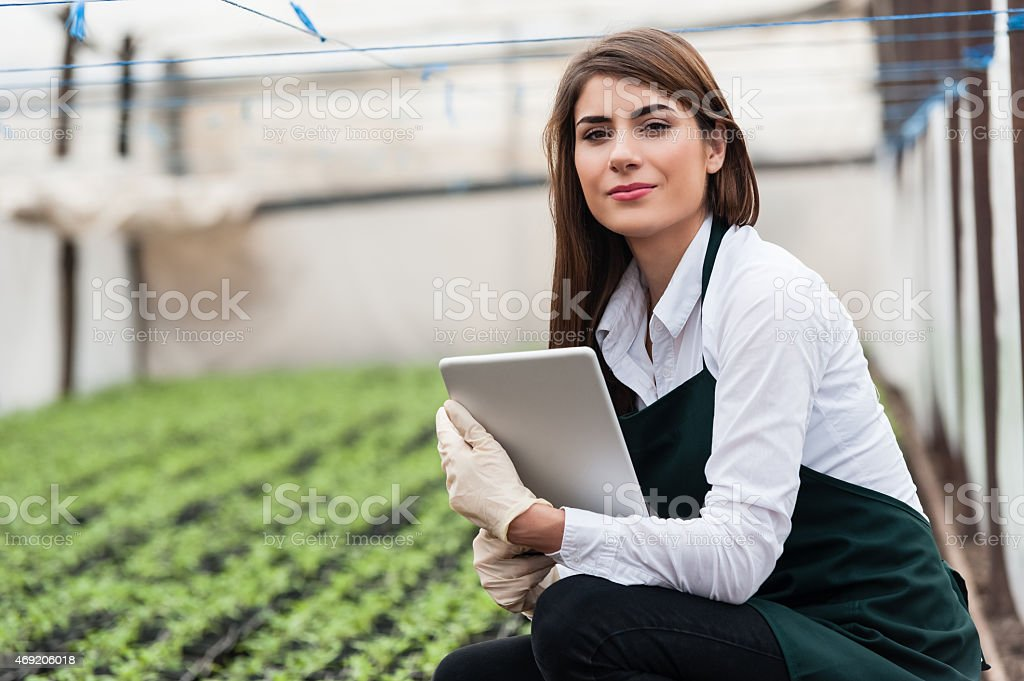 Female researcher technician studying with a tablet stock photo