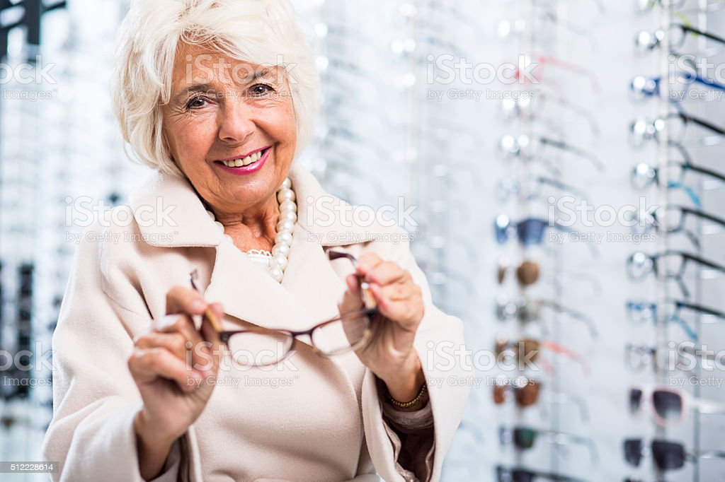 Female retiree in optician store stock photo