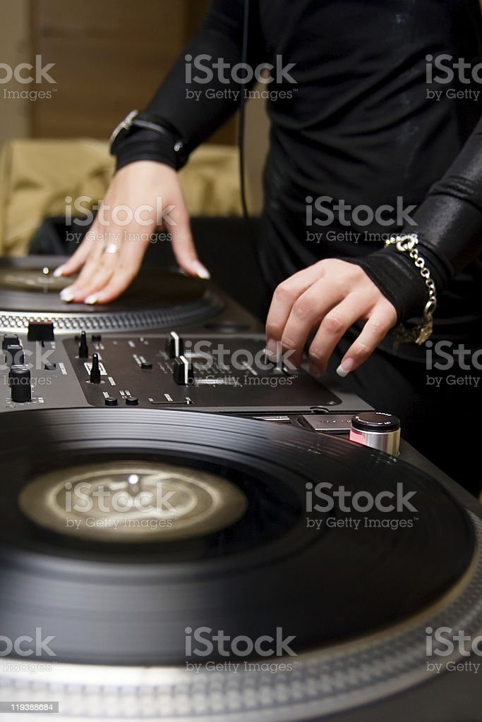 Female rnb deejay playing turntables stock photo