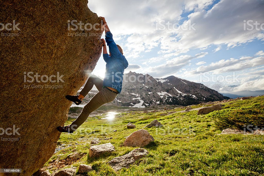 Female rock climber climbing a boulder problem royalty-free stock photo