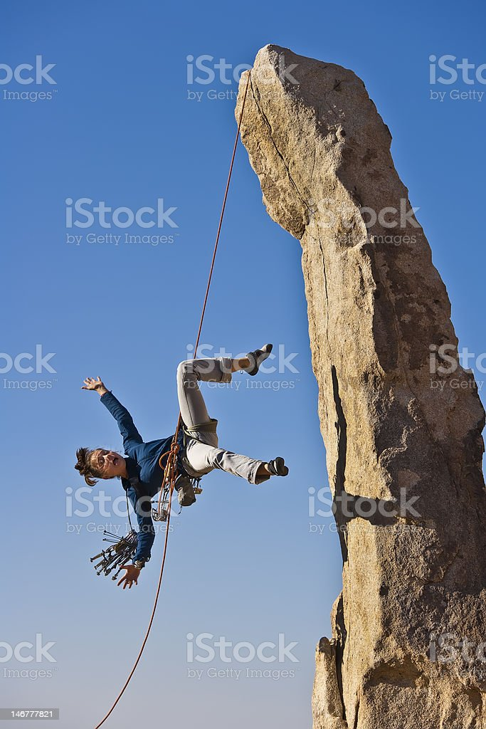 Female rock climber falling. royalty-free stock photo