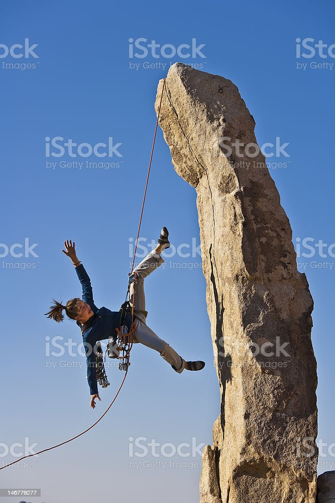 Female rock climber falling. stock photo