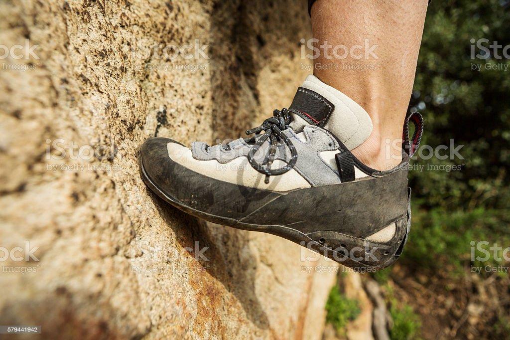 Female rock climber freeclimbing stock photo