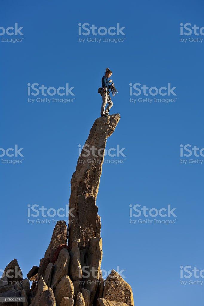 Female rock climber reaching the summit. royalty-free stock photo