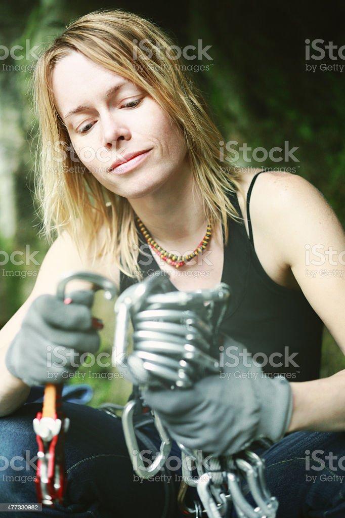 Female rock climber sitting on a stone stock photo