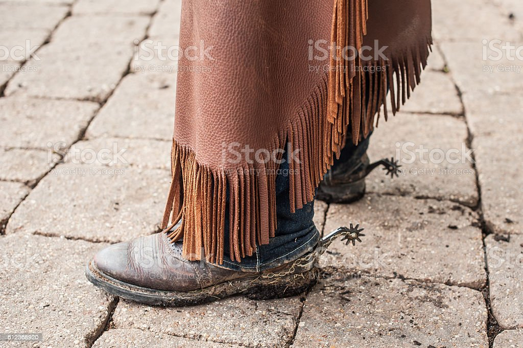 Female Rodeo Worker With Chaps and Boots stock photo