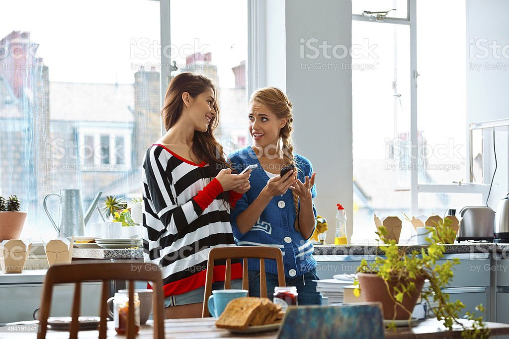 Female roommates stock photo