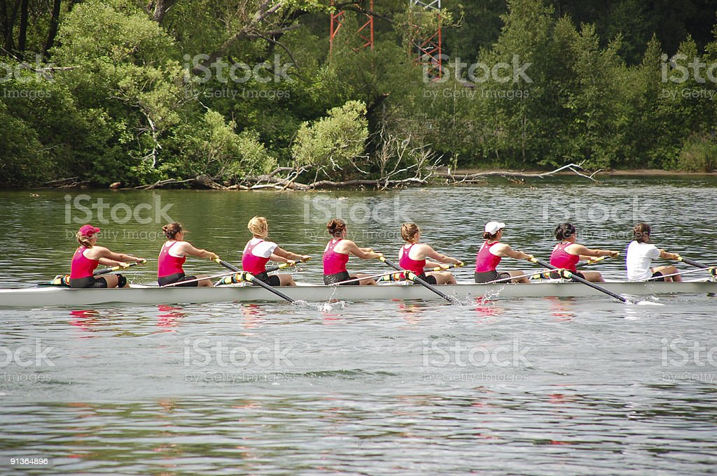 Female rowing team preparing for the next competition  stock photo