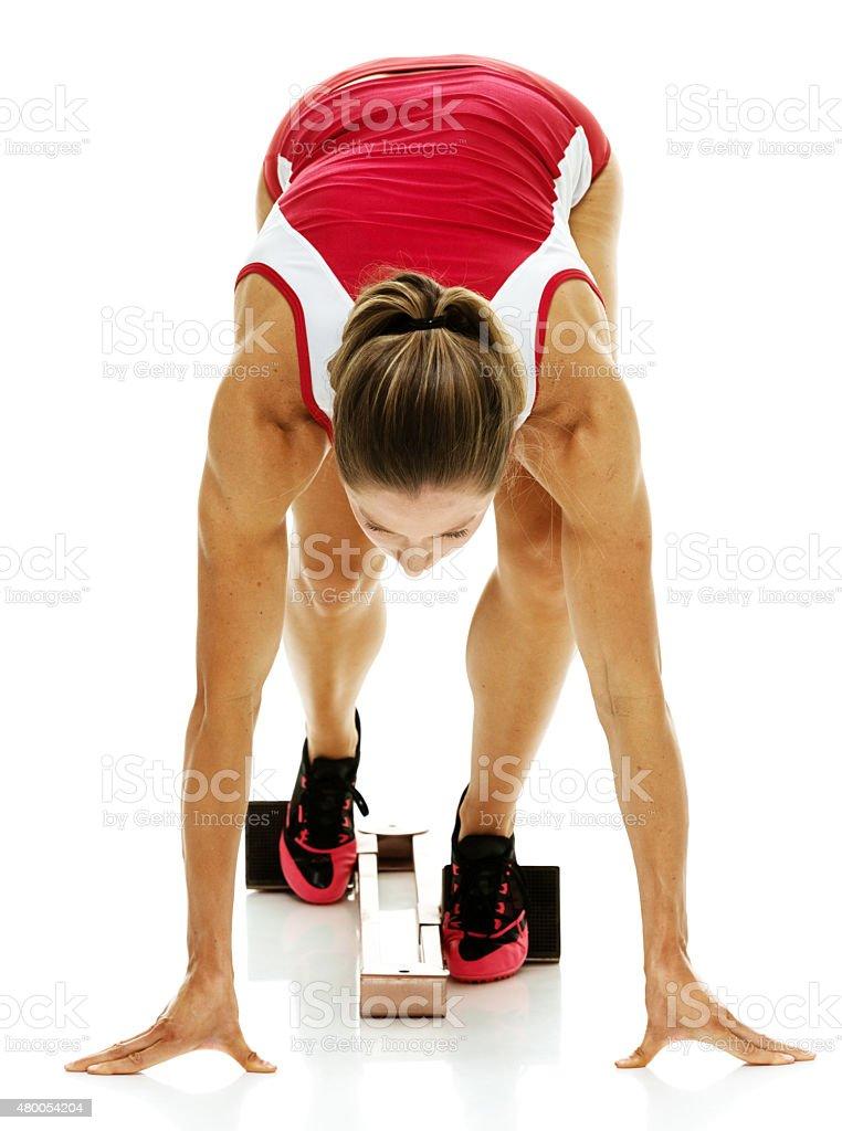 Female runner at the starting line stock photo