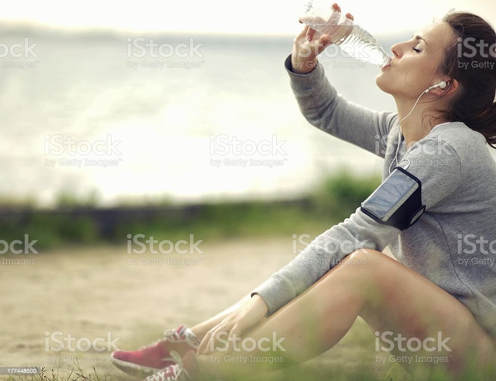 Female Runner Drinking Water stock photo