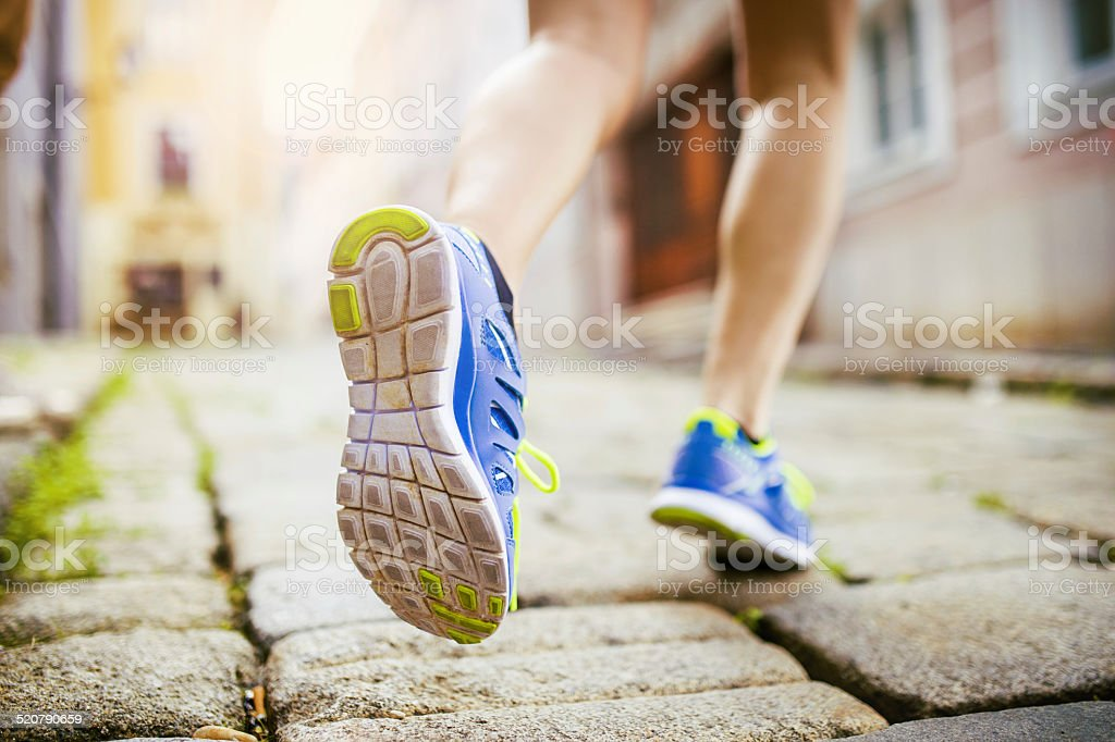 Female runner, feet closeup stock photo