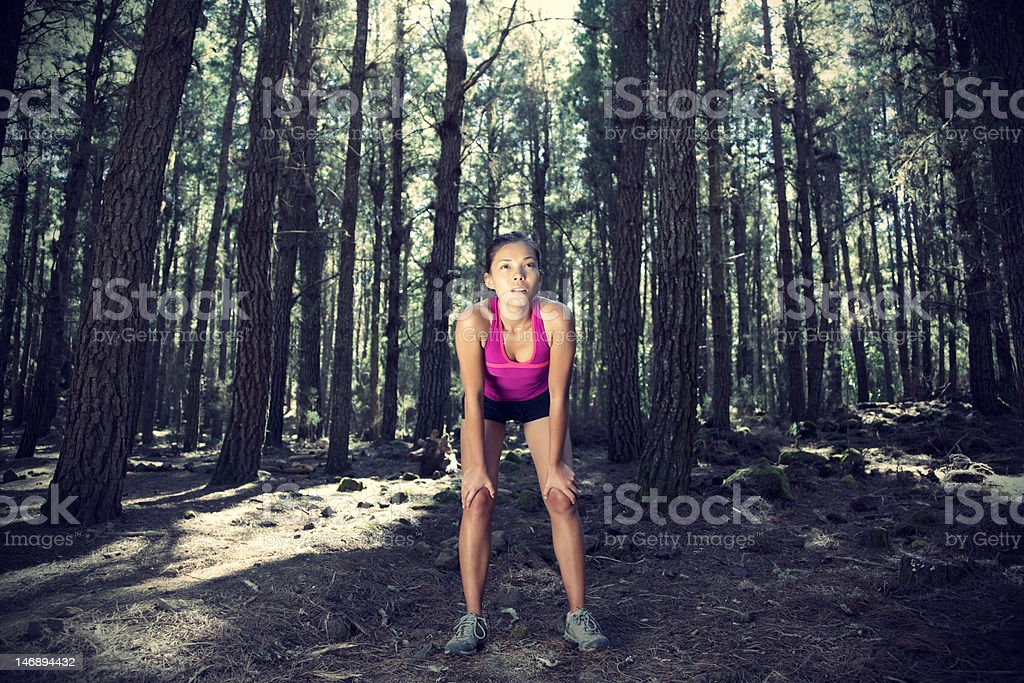 Female runner in forest royalty-free stock photo