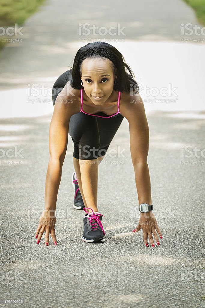 Female Runner in Starting Position for Sprint stock photo