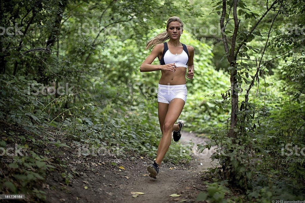 Female runner in the woods royalty-free stock photo