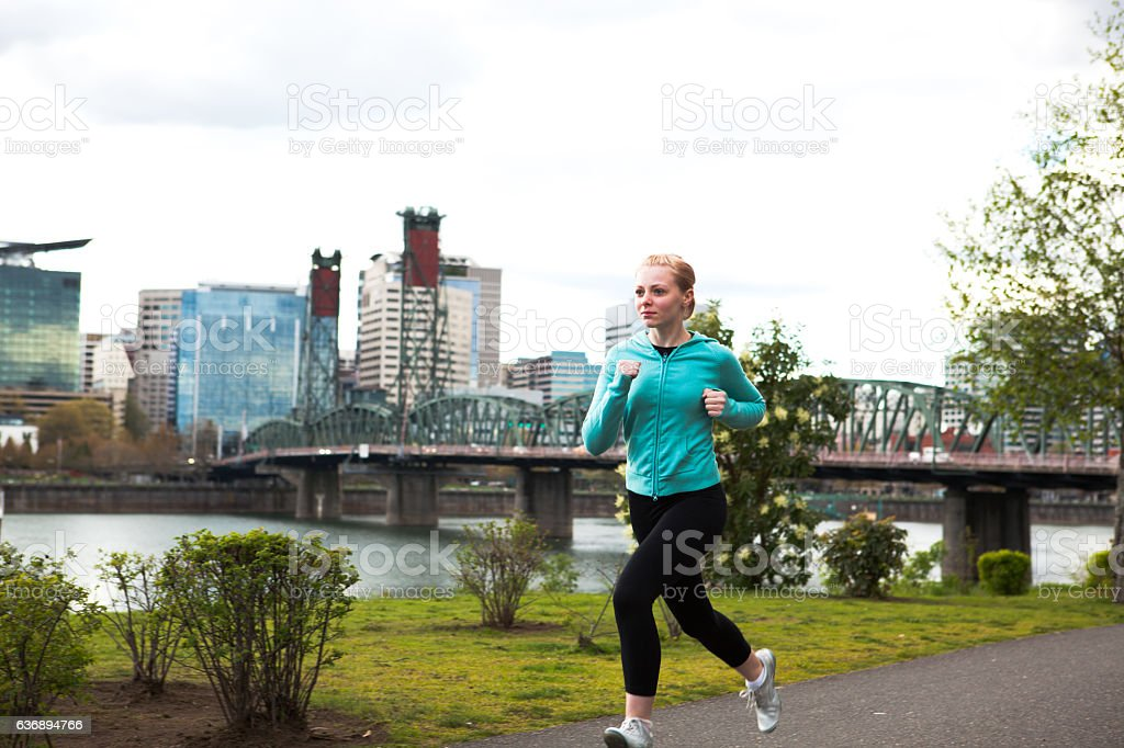 Female Runner Jogging in the City Downtown Portland stock photo