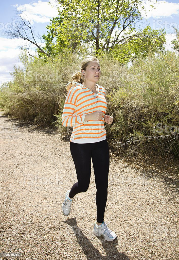 Female Runner jogging outdoors royalty-free stock photo