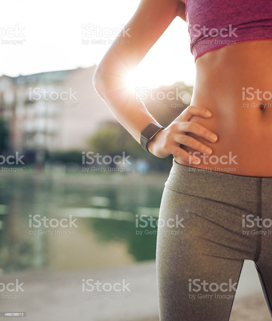 Female runner relaxing after sports training stock photo
