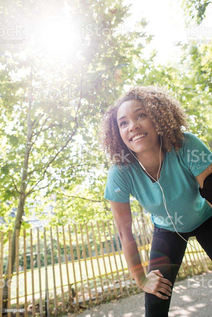 Female runner running at the park stock photo