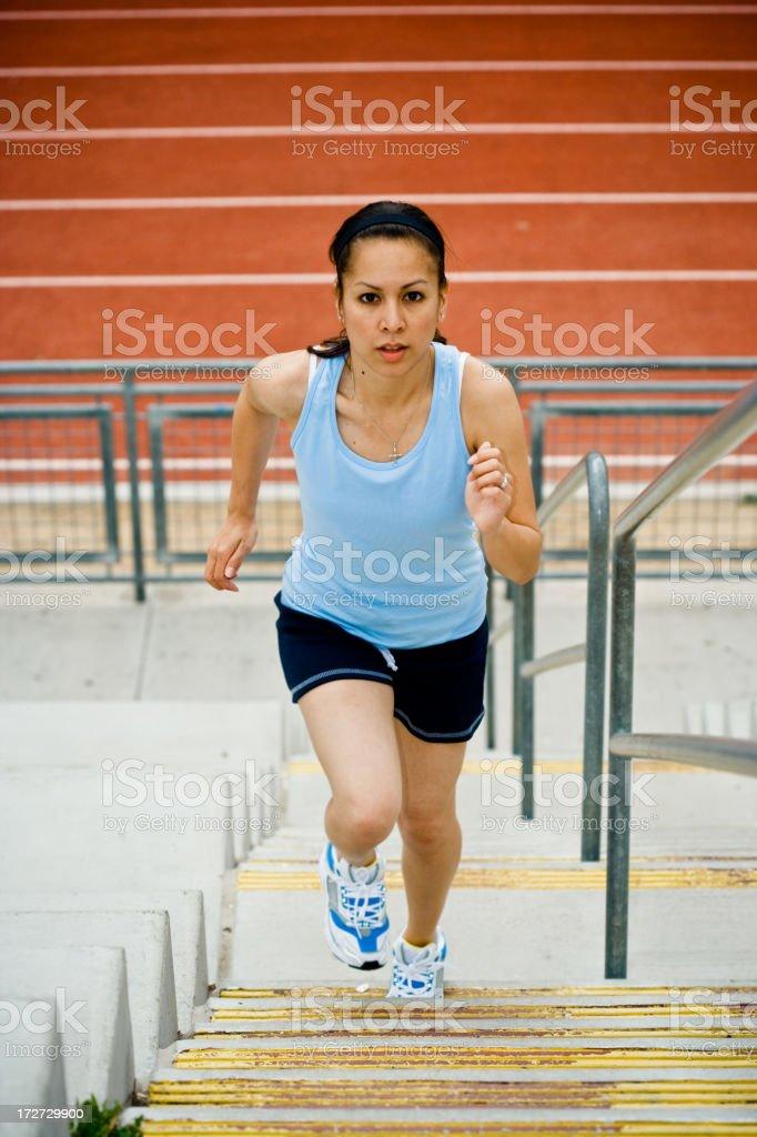 female runner running up stairs royalty-free stock photo