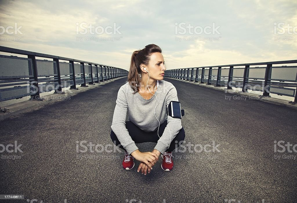 Female Runner Sitting stock photo