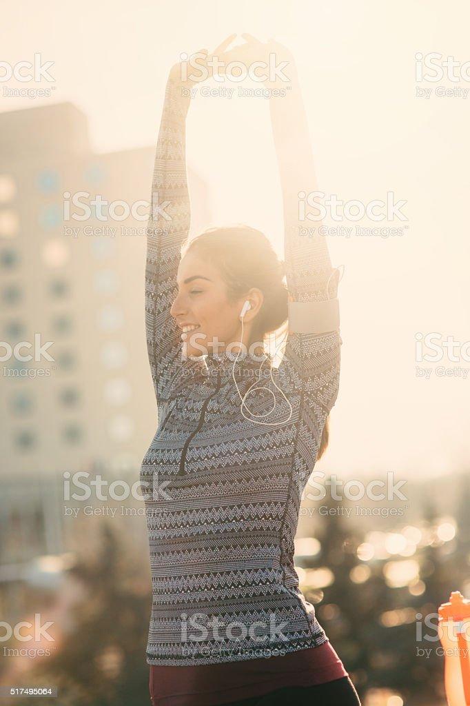 Female runner stretching stock photo