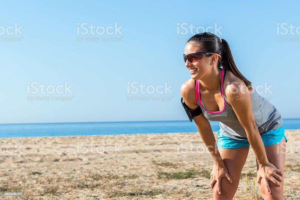 Female runner taking a rest. stock photo