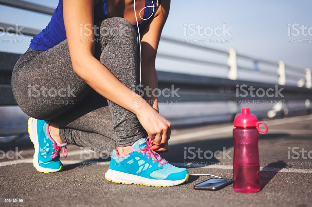 Female runner tying her shoes royalty-free stock photo