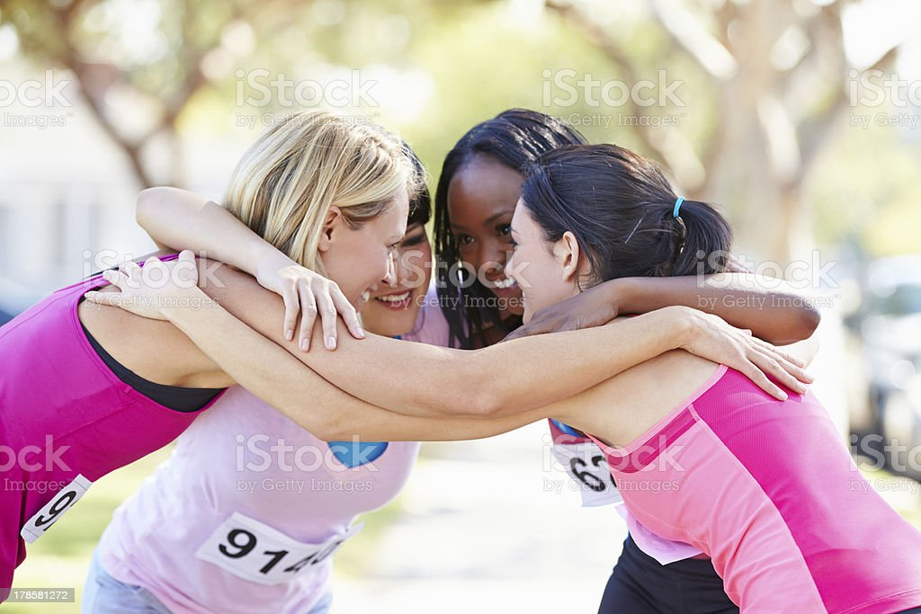 Female Runners Congratulating One Another After Race stock photo