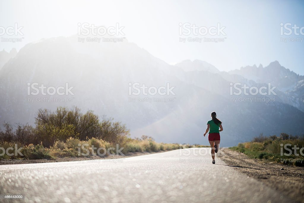 female running stock photo